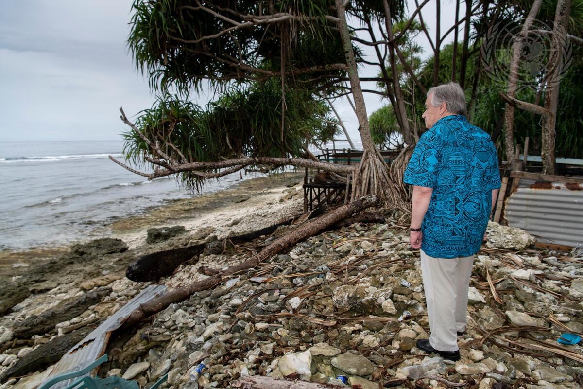 Figure 3. Secretary-General António Guterres looks out over the ocean in Tuvalu (2019). UN Photo/Mark Garten