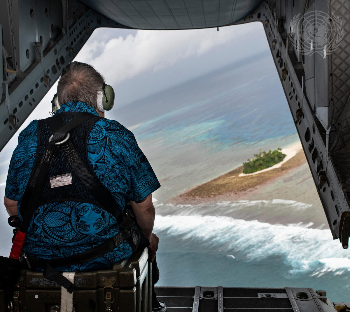 Figure 8. Secretary-General António Guterres looks out over the islands of Tuvalu from the back of the plane during his flight there in 2019. UN Photo/Mark Garten